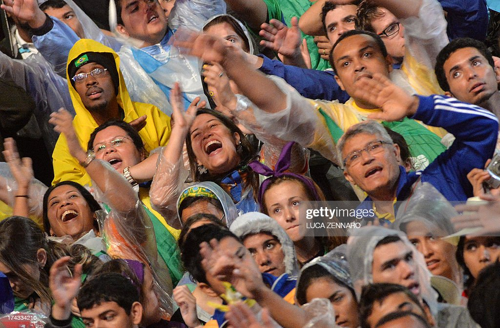 Catholic faithfuls attend the World Youth Day (WYD) opening mass, at Copacabana beach in Rio de Janeiro, Brazil, on July 23, 2013. The highlight of the landmark visit of Pope Francis to the world's most populous mainly Catholic country will be WYD, a five-day event that kicks off today. Pope Francis's popularity on his Latin American home turf posed a challenge to Brazilian authorities Tuesday after adoring crowds mobbed his car on his arrival on Monday.