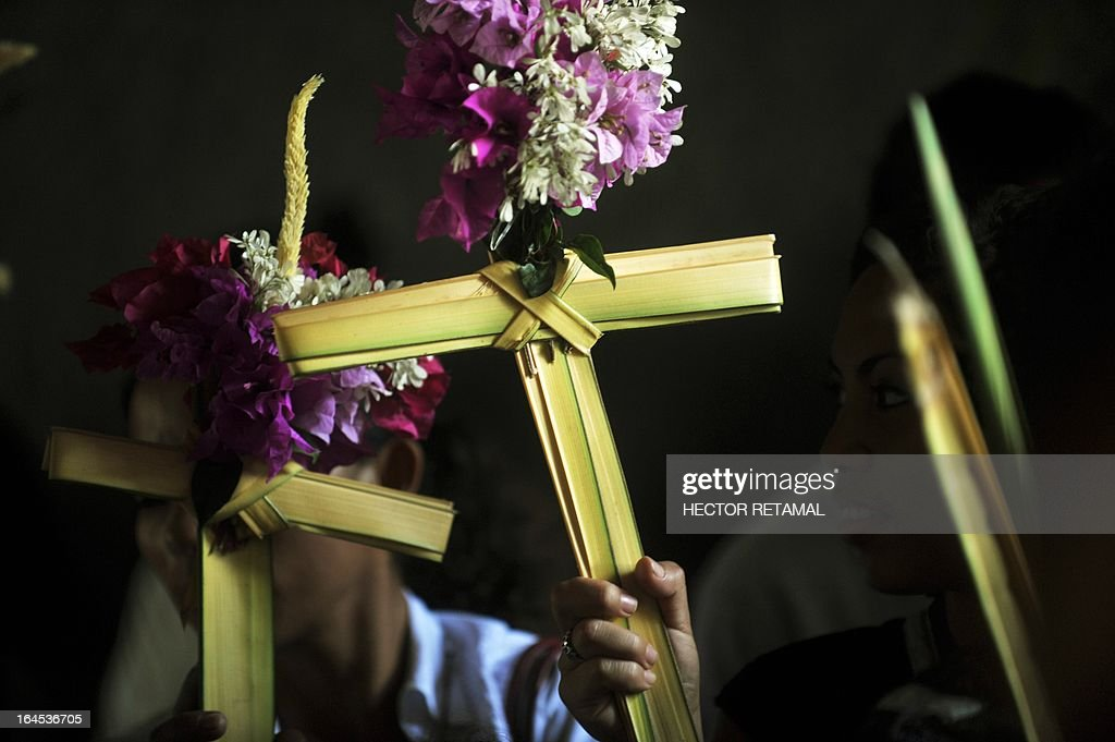 Catholic faithfuls participate in a Palm Sunday procession in Managua, on March 24, 2013. Palm Sunday marks the beginning of Holy Week, and commemorates Christ's triumphant entry into Jerusalem on the back of a donkey, welcomed by crowds waving palm branches, before his arrest, trial, crucifixion and resurrection. It is traditionally marked by a procession and special mass. AFP PHOTO/Hector RETAMAL