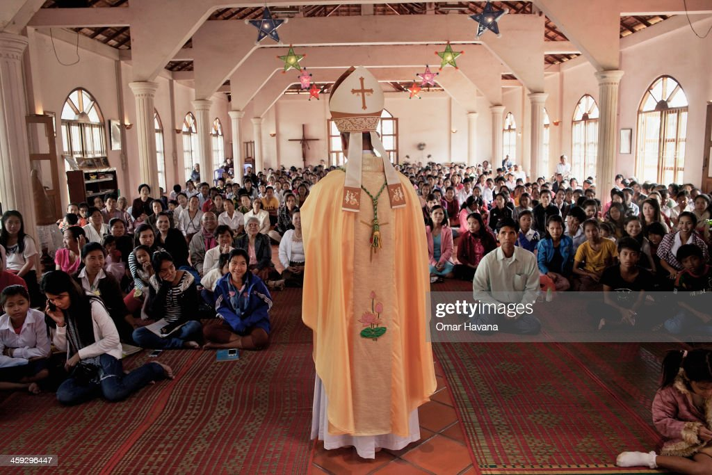 Catholic families attend the Christmas day mass at the church of Our Lady of the Assumption hosted by Monsignor Enrique Figaredo on December 25, 2013 in Battambang, Cambodia. The parish at Battambang dates back to 1790 when the Catholic community first arrived. Now they serve around 1000 Catholics and 600 families.