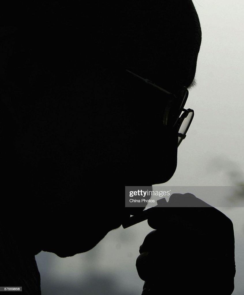 A catholic kisses a cross as he worships in a Catholic church on May 9, 2006 in Chongqing Municipality, China. China's official Catholic church named a new bishop on May 7, reportedly with papal approval, as Beijing rejected Vatican criticism of the unauthorized ordination of two other bishops. The Rev. Paolo Pei Junmin was named assistant bishop of Shenyang, the biggest city in China's northeast, said Liu Bainian, deputy chairman of the official church, the Chinese Patriotic Catholic Association, which has no ties to Rome, according to reports.