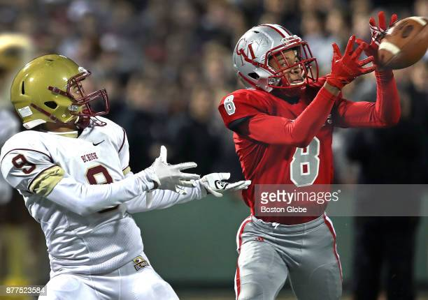 Catholic Memorial's Khari Johnson steps in front of Boston College High's Carter Rice for a first quarter interception Boston College High School...