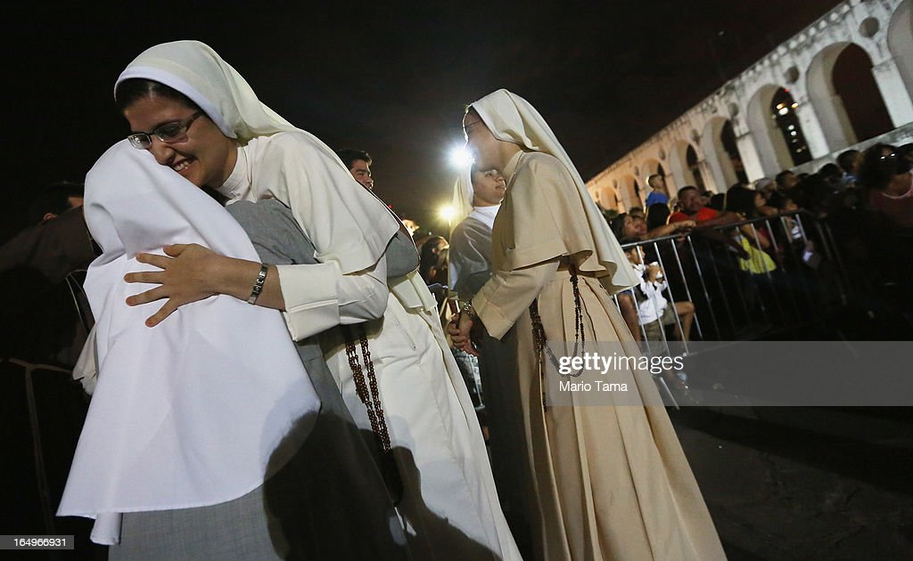 Catholic nuns hug following a Good Friday procession after Mass at the Metropolitan Cathedral on March 29, 2013 in Rio de Janeiro, Brazil. Pope Francis is the first pope to hail from South America, with Brazilian Catholics set to receive the pontiff during his visit to Brazil in July for a Catholic youth festival. Brazil has more Catholics than any other country.