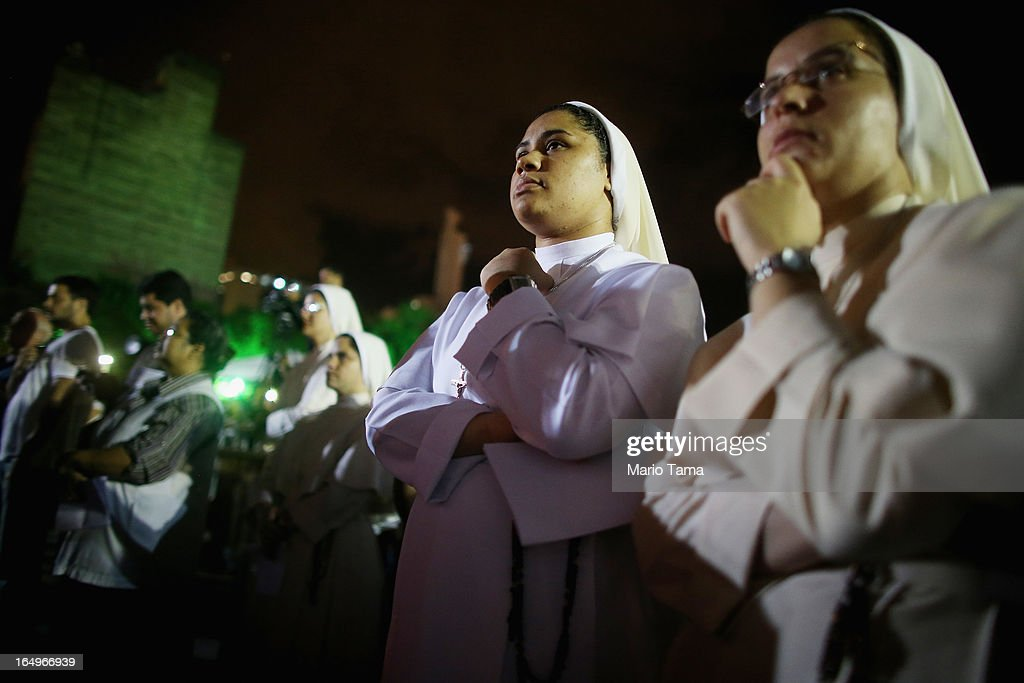 Catholic nuns look on following a Good Friday procession after mass at the Metropolitan Cathedral on March 29, 2013 in Rio de Janeiro, Brazil. Pope Francis is the first pope to hail from South America, with Brazilian Catholics set to receive the pontiff during his visit to Brazil in July for a Catholic youth festival. Brazil has more Catholics than any other country.