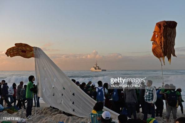 Catholic pilgrims attending World Youth Day who spent the night sleeping at Copacabana beach in Rio de Janeiro after a prayer vigil headed by Pope...