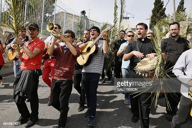 Catholic pilgrims take part in the traditional Palm Sunday procession from Mt Olives to Jerusalem's Old City on April 13 2014 The ceremony is a...