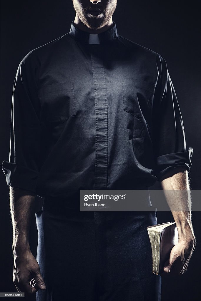 Catholic Priest Holding a Bible : Stock Photo
