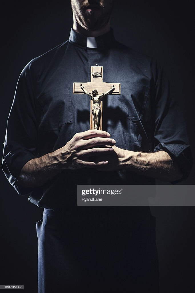 Catholic Priest Holding a Wooden Crucifix : Stock Photo