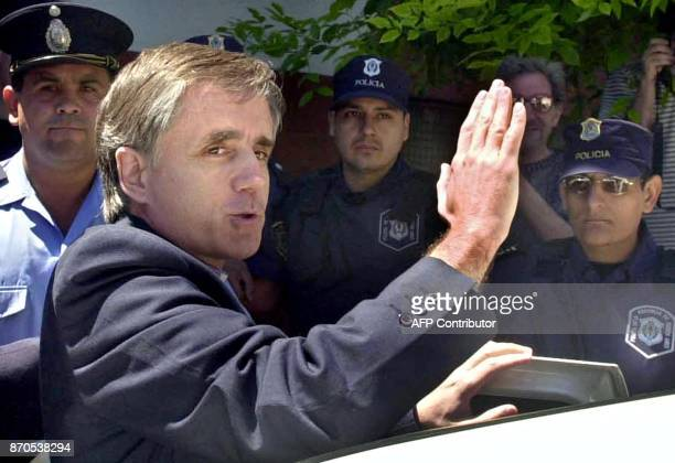 Catholic priest Julio Cesar Grassi waves as he leaves court where he is being charges with child abuse and curroption charges in Buenos Aires...