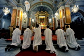 Catholic priests pray at the St Esprit Church during the Christmas mass at midnight in Harbiye downtown Istanbul on December 25 2010 AFP...