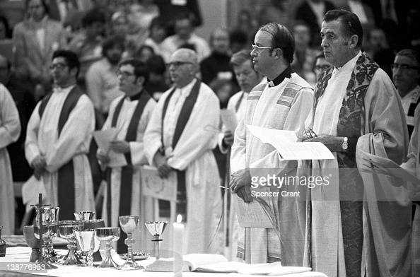Catholic priests prepare for a Mass at Boston College in Chestnut Hill Boston Massachusetts 1970