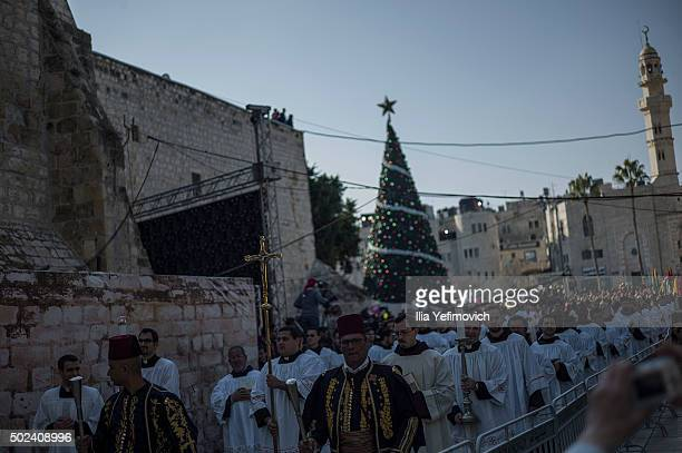 Catholic priests seen entering the church of nativity on December 24 2015 in Bethlehem West Bank Christians around the world start celebrating the...