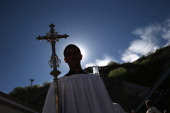 Catholic procession begins a special 'Mass on the Border' along the USMexico border fence on April 1 2014 in Nogales Arizona Catholic bishops led by...