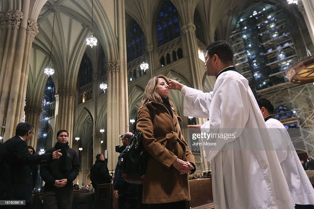 A Catholic receives ashes on her forehead while celebrating Ash Wednesday at St. Patrick's Cathedral on February 13, 2013 in New York City. Ash Wednesday marks the beginning of Lent, a 40-day period of pray and fasting for many Christians.