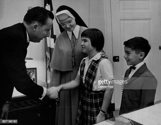 Catholic Schools Invite Mayor Anne Elizabeth Burns of 4533 Julian St and John Anthony Quintana of 4261 Grove St both pupils of St Catherine Catholic...
