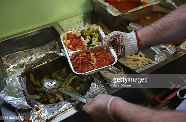 Catholic Services worker prepares 'meals on wheels' lunch delivery on March 12 2014 in Franklin New Jersey This year's harsh winter has left many...