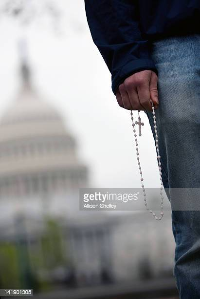 Catholic University student James Glasgow holds a rosary and prays during an vigil called 'Encircle the Court in Prayer' on March 25 2012 in...