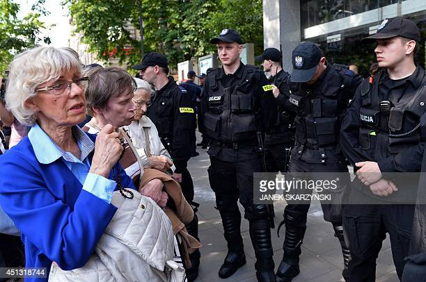 Catholic woman protest as policemen stand in front of a theater where a play 'Golgotha Picnic' by Argentinian author Rodrigo García was staged on...