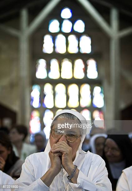 Catholic worshippers pray at the Church of the Annunciation believed to stand at the site of Mary's house where angel Gabriel appeared and announced...