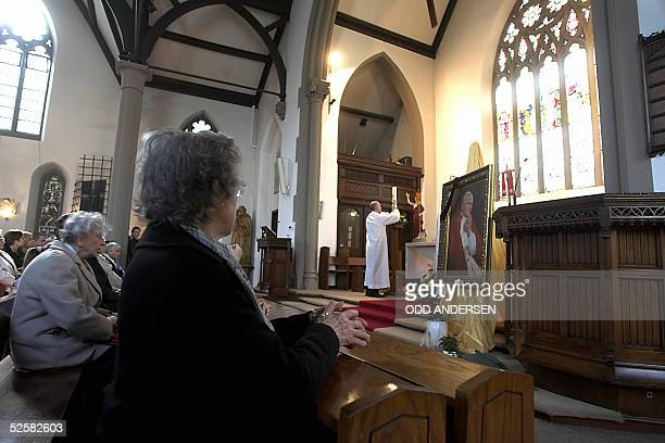 Catholics attend 03 April 2005 a mass at the Polish community church in the west London suburb of Ealing Hundreds of immigrant Poles came to pay...