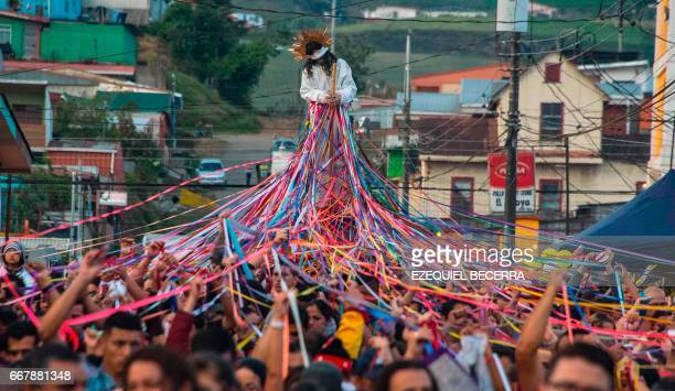 TOPSHOT Catholics carry a statue of Jesus Nazareno during a procession known as Jesus Nazareno of the tapes during Holy Week in Cot of Cartago 25 km...