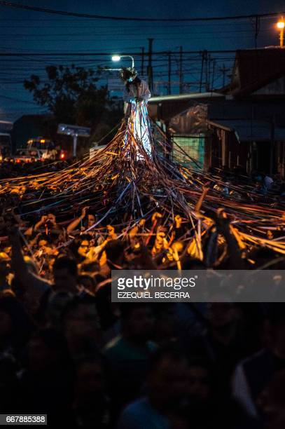 Catholics carry a statue of Jesus Nazareno during a procession known as Jesus Nazareno of the tapes during Holy Week in Cot of Cartago 25 km east of...