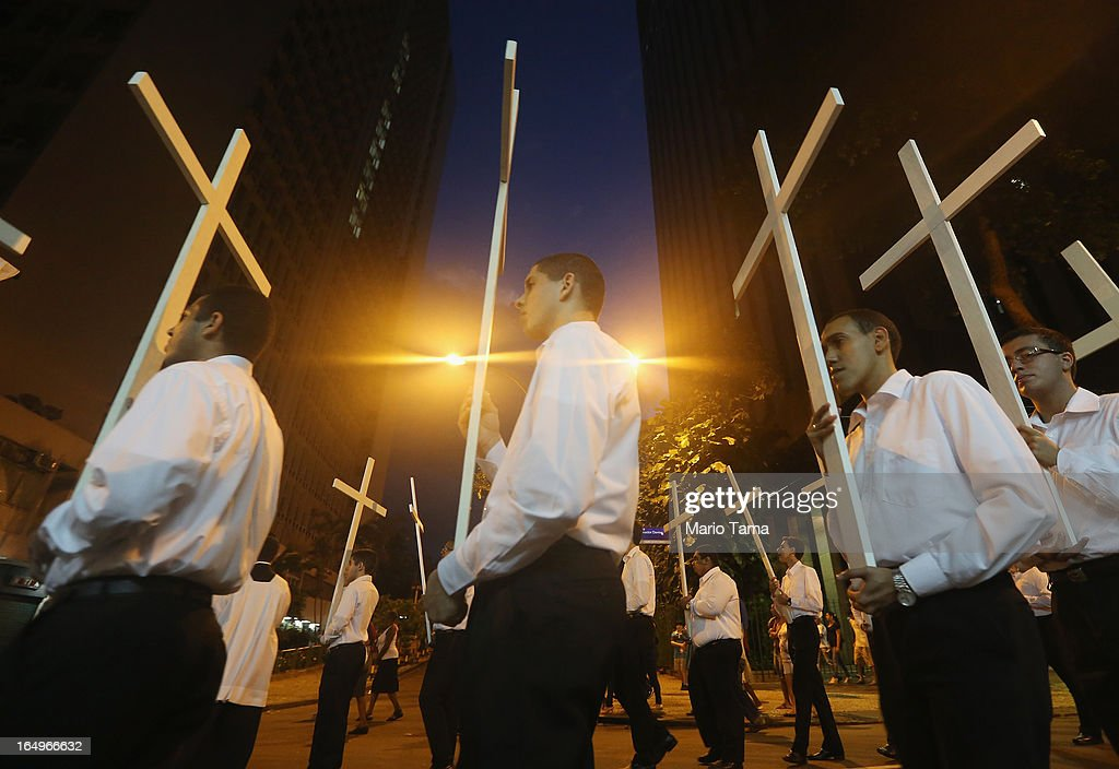 Catholics carry crosses in a Good Friday procession following Mass at the Metropolitan Cathedral on March 29, 2013 in Rio de Janeiro, Brazil. Pope Francis is the first pope to hail from South America, with Brazilian Catholics set to receive the pontiff during his visit to Brazil in July for a Catholic youth festival. Brazil has more Catholics than any other country.