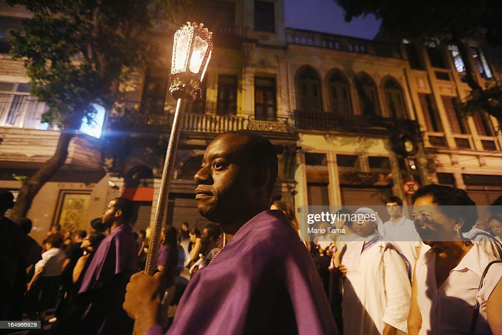 Catholics march in a Good Friday procession following Mass at the Metropolitan Cathedral on March 29, 2013 in Rio de Janeiro, Brazil. Pope Francis is the first pope to hail from South America, with Brazilian Catholics set to receive the pontiff during his visit to Brazil in July for a Catholic youth festival. Brazil has more Catholics than any other country.