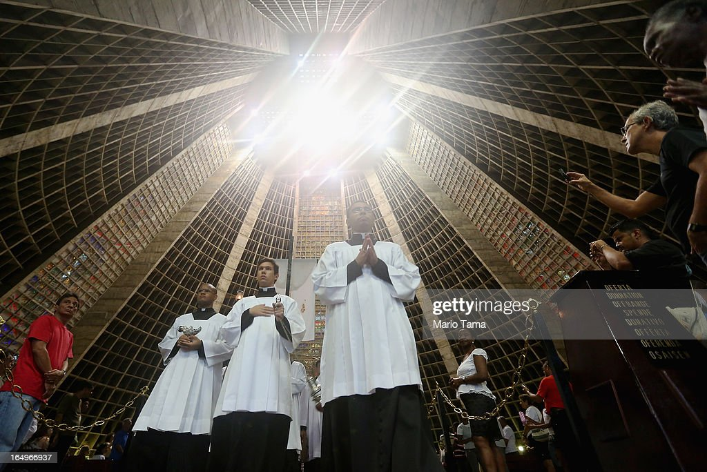 Catholics march in a Good Friday procession following Mass at the Metropolitan Cathedral on March 29, 2013 in Rio de Janeiro, Brazil. The conical shaped cathedral can accomodate 20,000 worshippers. Pope Francis is the first pope to hail from South America, with Brazilian Catholics set to receive the pontiff during his visit to Brazil in July for a Catholic youth festival. Brazil has more Catholics than any other country.