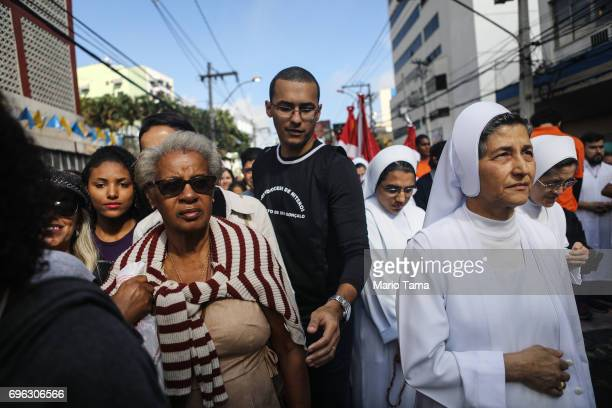 Catholics march in a procession while celebrating the holiday of Corpus Christi on June 15 2017 in Sao Goncalo Brazil The tradition is marked on the...