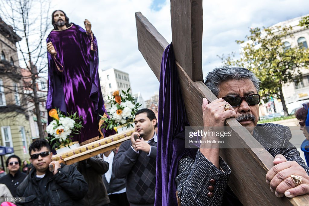 Catholics march through downtown on Good Friday in the Via Crucis, or Way of the Cross procession on March 29, 2013 in Washington, DC. The event is one of many Holy Week activities in the lead up to Easter Sunday.