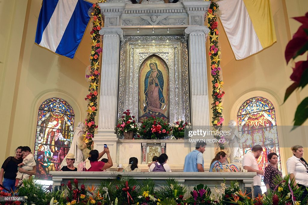 Catholics participate in a religious festivity in honor of the Virgin of Guadalupe at the Guadalupe Basilica in Antiguo Cuscatlan El Salvador on...