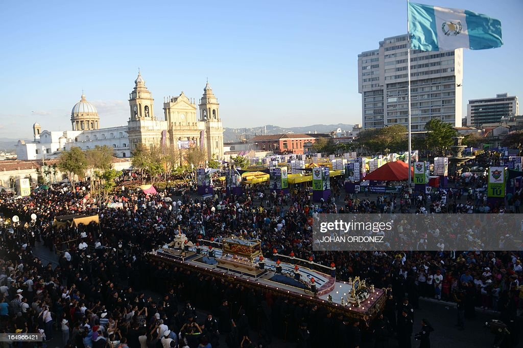 Catholics participate in Good Friday's 'Santo Entierro' (Holy Burial) procession, held as part of Holy Week celebrations, in Guatemala City, on March 29, 2013. AFP PHOTO Johan ORDONEZ