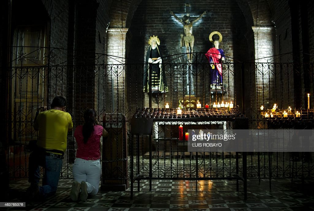Catholics pray during the celebration of Ash Wednesday marking the beginning of Lent a period of penitence for Christians before Easter in Cali...
