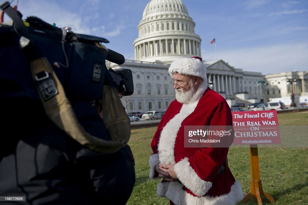 Catholics United hold a press conference with Santa Claus in front of the U.S. Capitol to rebut the GOP's budget effort sin the ongoing 'Fiscal Cliff' fight on the Hill. The group claims that the GOP is not making 'moral choices,' and should side with 98% of taxpayers who not be affected by 'taxes on the rich.'