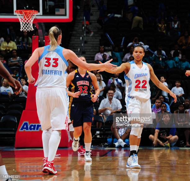 Cathrine Kraayeveld and Armintie Price of the Atlanta Dream celebrate after a score against the Indiana Fever at Philips Arena on June 26 2012 in...