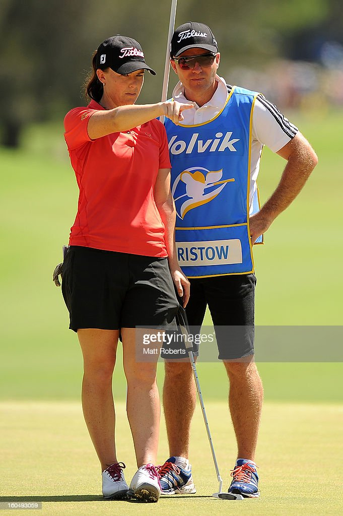 Cathryn Bristow of New Zealand speaks with her caddy on the first green during the Australian Ladies Masters at Royal Pines Resort on February 2, 2013 on the Gold Coast, Australia.