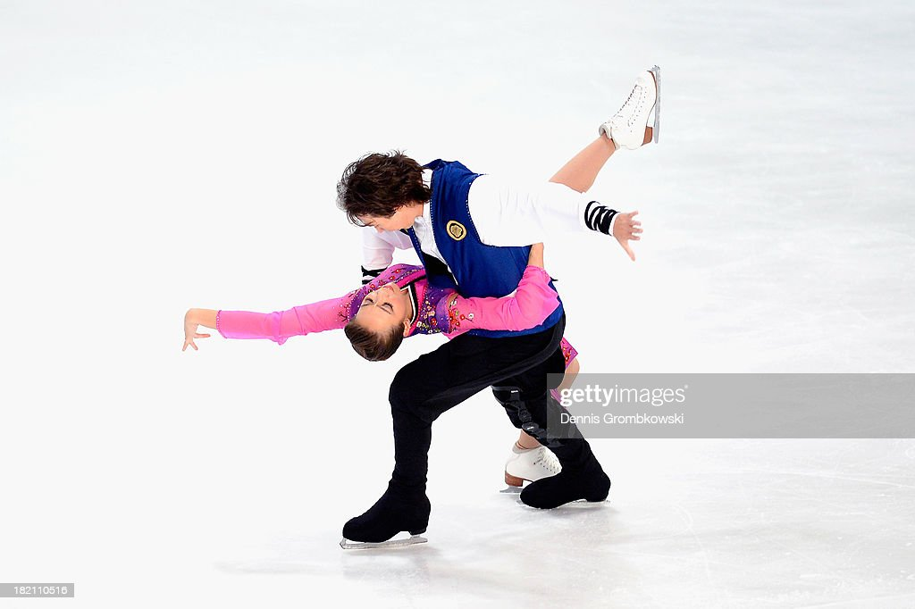 Cathy and Chris Reed of Japan compete in the Ice Dance Free Dance competition during day three of the ISU Nebelhorn Trophy at Eissportzentrum Oberstdorf on September 28, 2013 in Oberstdorf, Germany.