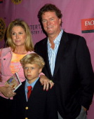Cathy and Rick Hilton with son during Premiere and Benefit Party for 'Barbie As Rapunzel' at FAO Schwartz in New York New York United States