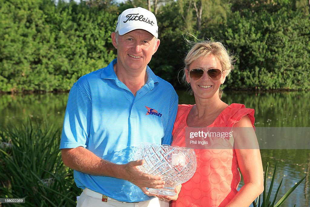 Cathy and <a gi-track='captionPersonalityLinkClicked' href=/galleries/search?phrase=Roger+Chapman&family=editorial&specificpeople=569611 ng-click='$event.stopPropagation()'>Roger Chapman</a> of England pose with the John Jacobs Trophy for winning the Order of Merit for 2012 after the final round of the MCB Tour Championship played at the Legends Course, Constance Belle Mare Plage on December 9, 2012 in Poste de Flacq, Mauritius.