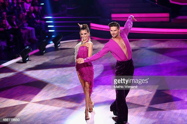 Cathy Fischer and Marius Lepure perform on stage during the 1st show of the television competition 'Let's Dance' on March 13 2015 in Cologne Germany