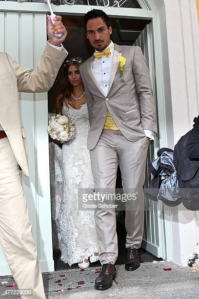 Cathy Fischer and Mats Hummels exit the registry office at Mandlstrasse after their wedding on June 15 2015 in Munich Germany