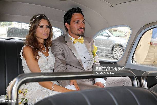 Cathy Fischer and Mats Hummels sit in their wedding car after their wedding on June 15 2015 in Munich Germany