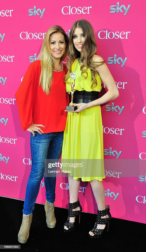 Cathy Fischer (R), girlfriend of Dortmund's defender Mats Hummels, and pesenter Andrea Kaiser pose with the award during the 'Beliebteste Spieler-Frau Deutschlands 2013' Press Reception at Museum Brandhorst on May 27, 2013 in Munich, Germany. Cathy Fischer has won the titel as 'Beliebteste Spieler-Frau Deutschlands 2013' ('Germany's most popular player's wife').