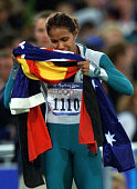 Cathy Freeman of Australia kisses the Australian and Aboriginal flags after winning the Olympic gold in the 400m final 25 September 2000 at the...