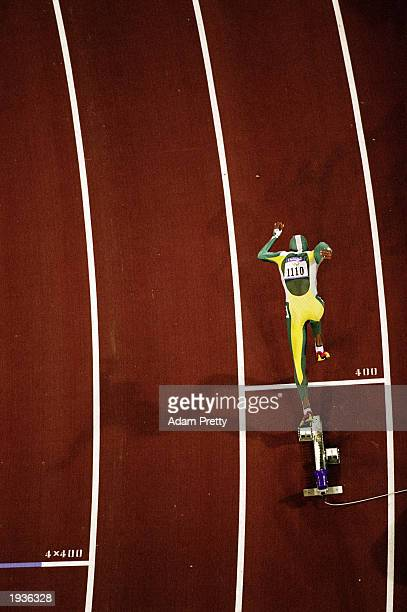 Cathy Freeman of Australia rises out of the blocks at the start of the Womens 400m Final at the Olympic Stadium on Day 10 of the Sydney 2000 Olympic...