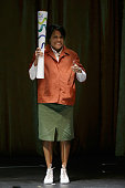 Cathy Freeman stands on stage arrives at the Prime Minister's Olympic Dinner at The Melbourne Convention and Exhibition Centre on June 18 2016 in...