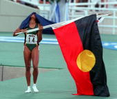 Cathy Freeman with the Australian and Aboriginal flags after victory in the 400 metres final at the World Athletics championships in AthensGreece...