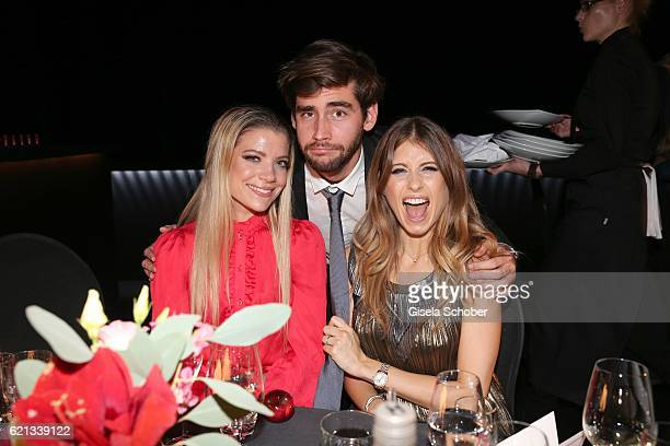 Cathy Hummels and her sister Vanessa Fischer and Alvaro Soler during the aftershow party of the 23rd Opera Gala at Deutsche Oper Berlin on November 5...