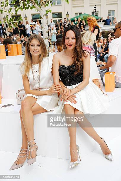Cathy Hummels and Johanna Klum attend the presentation of the Rauch Happy Day Limited Edition designed by Marina Hoermanseder ahead of the Marina...