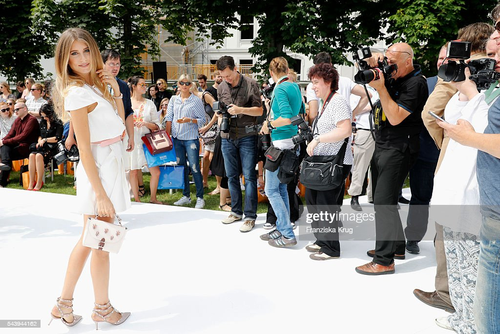 <a gi-track='captionPersonalityLinkClicked' href=/galleries/search?phrase=Cathy+Hummels&family=editorial&specificpeople=8685062 ng-click='$event.stopPropagation()'>Cathy Hummels</a> poses in front of the photographers during the presentation of the Rauch Happy Day Limited Edition designed by Marina Hoermanseder ahead of the Marina Hoermanseder defilee during the Der Berliner Mode Salon Spring/Summer 2017 at Kronprinzenpalais on June 30, 2016 in Berlin, Germany.